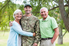 Soldier reunited with his parents. On a sunny day Royalty Free Stock Photography