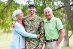 Soldier reunited with his parents. On a sunny day Stock Photography