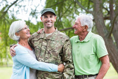 Soldier reunited with his parents. On a sunny day Stock Photo