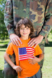 Soldier reunited with his son stock photos