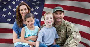 Soldier reunited with their family. Against american flag royalty free stock photo