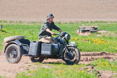Soldier rides a BMW R12 bike Stock Images