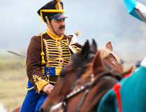 A soldier rides a brown horse. Royalty Free Stock Image
