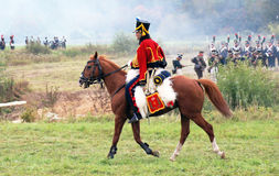 A soldier rides a brown horse. Stock Image