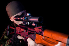 Soldier with rifle. Selective focus on face Royalty Free Stock Images