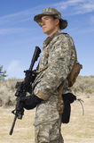 Soldier With Rifle. American soldier in army camouflage uniform holding rifle stock photography