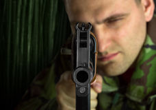 Soldier with rifle AK-47. Aiming to you Stock Images