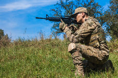 Soldier with a rifle Stock Images
