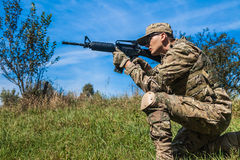 Soldier with a rifle. In the field Stock Image