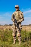 Soldier with a rifle. In the field Royalty Free Stock Photos