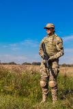 Soldier with a rifle. In the field Stock Photo
