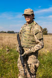 Soldier with a rifle. In the field Stock Photos