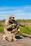 Soldier with a rifle. In the field Stock Photography