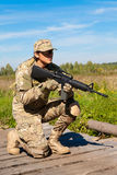 Soldier with a rifle. In the field Royalty Free Stock Images
