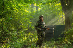 Soldier with rifle in forest Royalty Free Stock Photography
