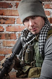 Soldier with rifle looking at camera Royalty Free Stock Images