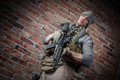 Soldier with rifle looking at camera Royalty Free Stock Photography