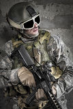 Soldier with rifle and mask Stock Images