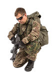 Soldier with rifle on a white background Stock Photography