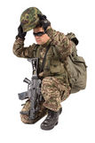 Soldier with rifle on a white background Stock Photo
