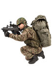 Soldier with rifle on a white background Royalty Free Stock Image