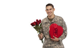 Soldier with roses and gift Stock Photography