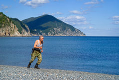 Soldier runs at sea 1 Stock Photography