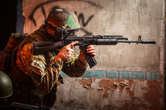 Soldier with the russian machine gun in abandoned building Royalty Free Stock Photo