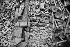 WW1 Soldiers buckles and buttons. Various parts of soldiers uniforms, shrapnel, bomb parts and other unearthed parafernalia; personal remnants of World War 1 Stock Photo