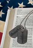 Soldier's Faith. Tribute to a soldier on military dog tags royalty free stock photo