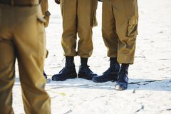 The soldier`s footwear of the Israeli army which is put on legs in clear sunny day.  Stock Photography