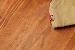Soldier's forage cap with a red star. May 9 Victory Day Stock Image