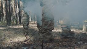 Soldier`s legs walk through the forest.  stock footage