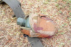 Soldier's water bottle. Lying on the ground Stock Photography