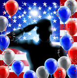 Soldier Salute Concept. Patriotic soldier or veteran saluting in front of an American flag fourth July or independence day background with red white and blue Stock Image