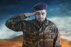 Soldier Salutes ready to serve and sacrifice Royalty Free Stock Photo