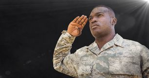 Soldier saluting against black background with grunge overlay and flare Stock Image