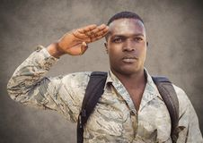 Soldier saluting against brown background with grunge overlay Stock Images