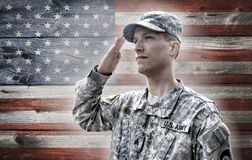 Soldier saluting on the grunge american flag backg Stock Photo