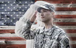 Soldier saluting on the grunge american flag background Stock Images