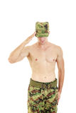 Soldier saluting standing proud and serious in military uniform Royalty Free Stock Photo