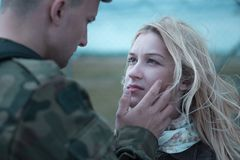 Soldier saying goodbye. To beauty upset wife Stock Photos