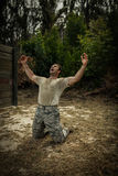 Soldier screaming with arms wide open Stock Photos
