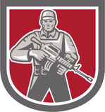 Soldier Serviceman With Assault Rifle Shield. Illustration of a soldier serviceman with assault rifle facing front set inside shield crest shape on isolated Royalty Free Stock Photos