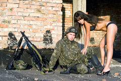 Soldier  with sexy woman Stock Photography