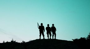Soldier shiluettes. The shiluette of soldiers with bluegreen sky Royalty Free Stock Images