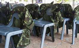 Soldier shirt lean on chair Royalty Free Stock Photo