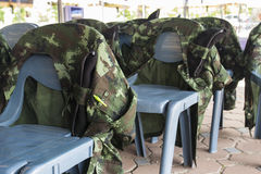 Soldier shirt lean on chair Stock Photo