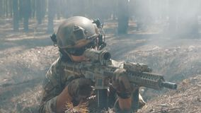 Soldier shoots from behind cover.  stock footage