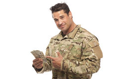 Soldier showing money Royalty Free Stock Images
